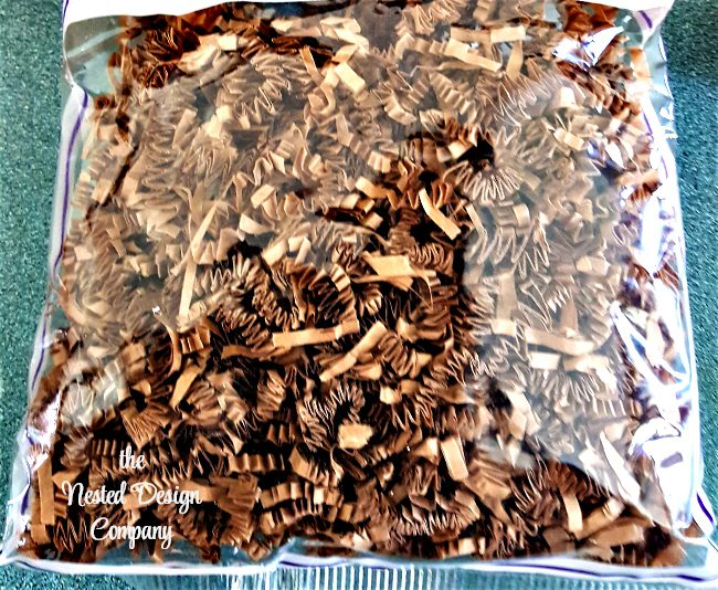 paper shreds-cork pumpkin-how-to-make-wine-cork-pumpkins-www.nesteddesigncompany.com