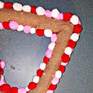 Valentines Day Heart Wreath made with foam heart and pom poms in pink, red and white