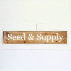 Farmhouse seed and supply sign