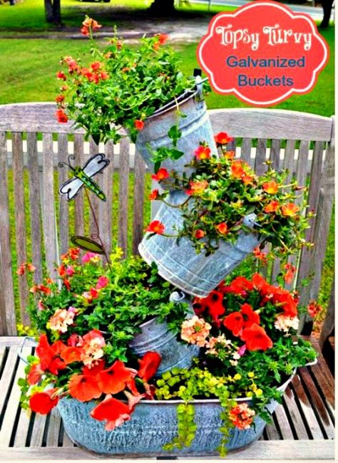 Galvanized bucket topsy turvy planter
