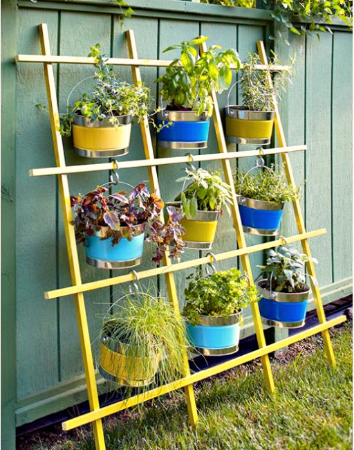 Trellis planter filled with colorful potted plants